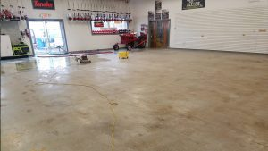Soiled Dirty Oiling Showroom In Need of Floor Stripping, Waxing & Refinishing